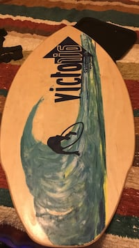 white and blue Victor16 surfboard 761 mi