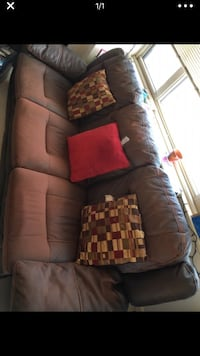 Dual power recliner leather sofa.