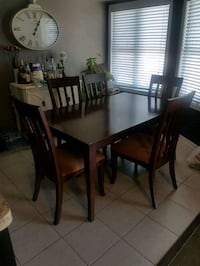 Hardwood table comes with 6 chairs and extension