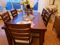 Solid wooden dining table with 6 chairs.