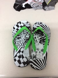 Pair of black-and-white flip flops.