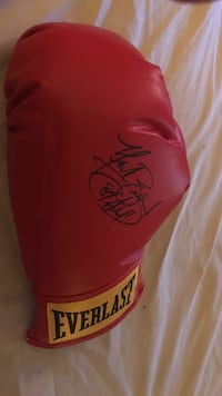 Unpaired autographed red everlast boxing glove