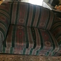 green and brown stripe sofa chair