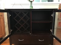 black wooden TV hutch with flat screen television Omaha, 68131