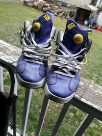 purple-and-yellow high-top sneakers