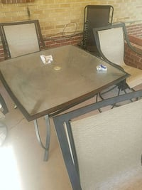 rectangular brown wooden table with chairs Denver, 80238