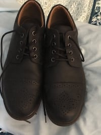pair of black leather shoes Manchester, 03103