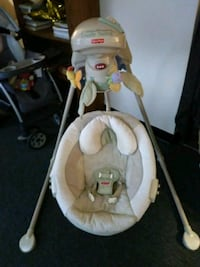 Baby's white and green cradle and swing