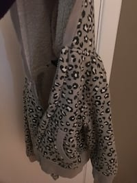 gray, black, and white leopard pattern zip-up hoodie