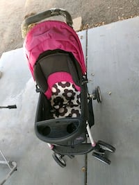 baby's pink and black stroller North Las Vegas, 89031