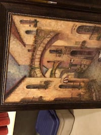 Brown wooden framed painting of house Vaughan