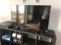 black flat screen TV with black wooden TV stand Chicago, 60616