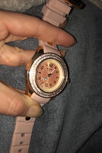 PINK Kyboe rubber band watch with diamond perimeter from Australia.
