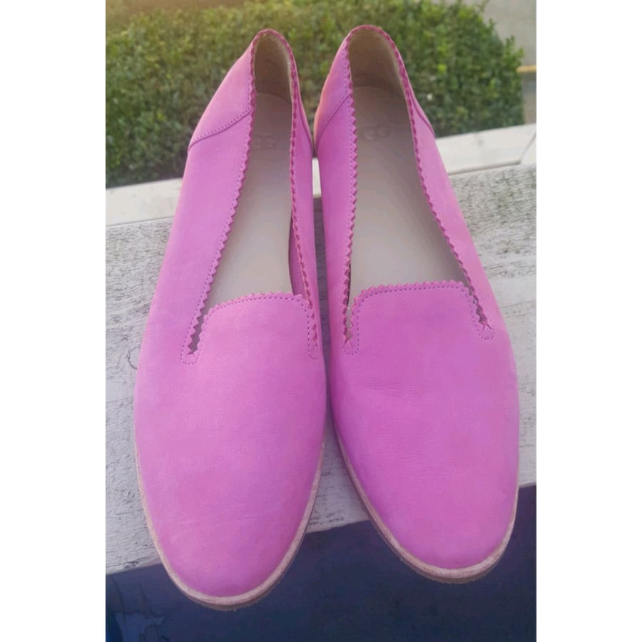 pair of pink slip on shoes