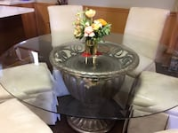 Dining Table with 6 chairs barely used stains resistant with heavy metal Base thick 50'glass Mississauga, L5L