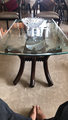 glass top table with brown base