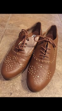 pair of brown leather oxford dress shoes
