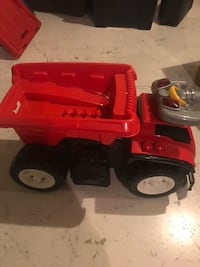 Large toddler's red and black truck plastic toy