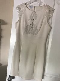 Beautiful white BEBE dress. Size M. Worn once. Calgary, T2Y 4J3
