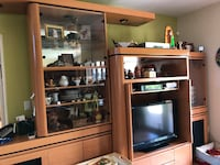 flat screen television with brown wooden TV hutch