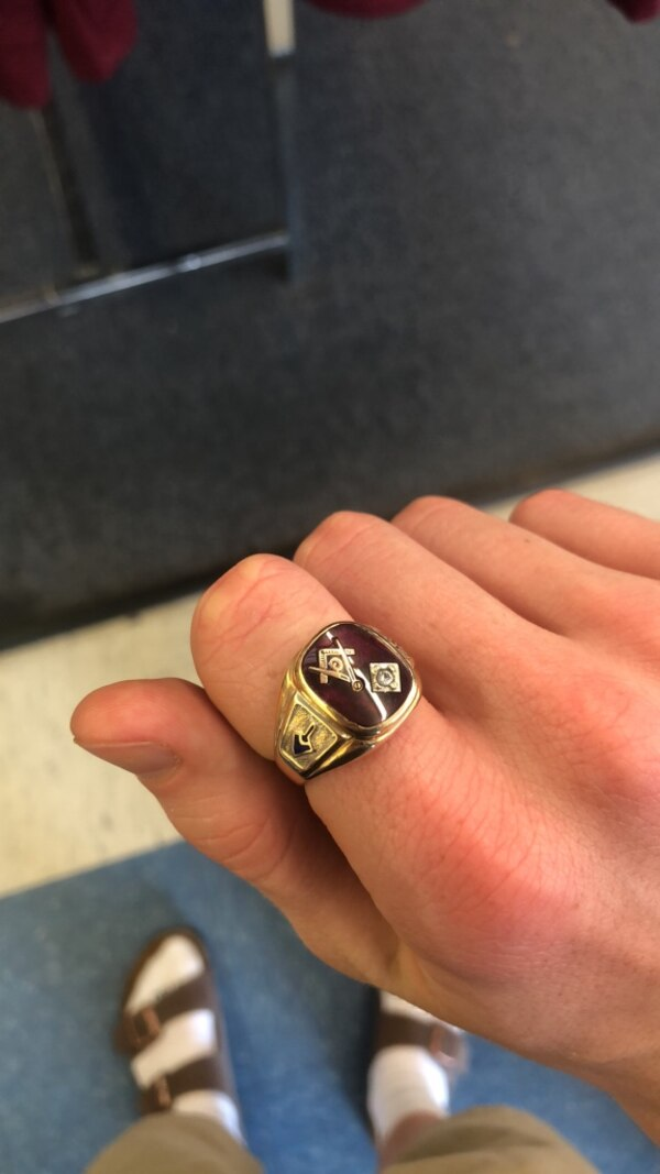 10k gold freemasons ring. With small diamond. And full ruby.  Price negotiable. 1300 new