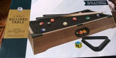 Play a variety of pool games  With this tabletop billiard table