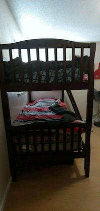 black wooden bed frame with red bed sheet Los Angeles, 90095