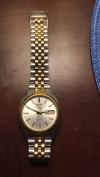 round gold-colored analog watch with link bracelet 2051 mi