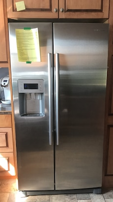 silver Samsung side-by-side refrigerator with dispenser