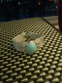 silver-colored and blue gemstone ring Calgary, T3C 0T1