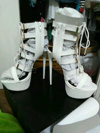 pair of white leather open-toe gladiator sandals Toronto, M3M 2H2