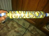 yellow brown and blue rolling pin