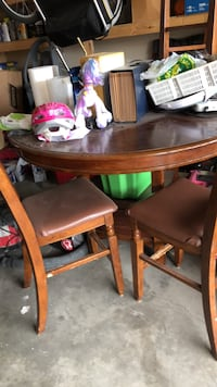 oval brown wooden dining table Calgary, T3J 4V5