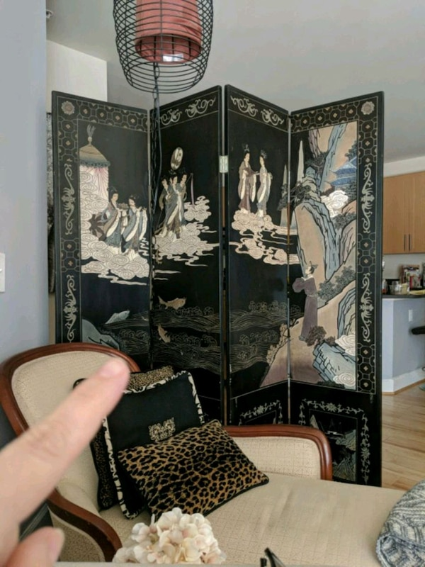 This is an antique Oriental room divider.
