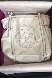 White coach bag with cloth bag cover and box