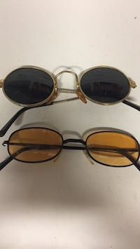 Two gold and black frame sunglasses Ironton, 45638