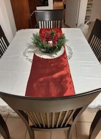 Dining table set with chairs and decor
