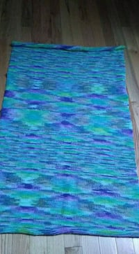 blue and green stripe textile
