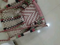 white and red knitted textile