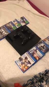 black Sony PS4 with game cases Burnaby, V3J