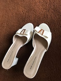 pair of white leather peep toe heels Vancouver, V6H 1Y2