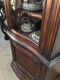 2 Lighted long display Cabinets with unique curved glass. CASH ONLY