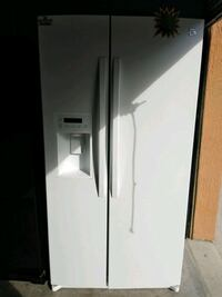 white side-by-side refrigerator with dispenser 894 mi