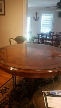 round brown wooden table with threechairs dining s Pembroke, 02359