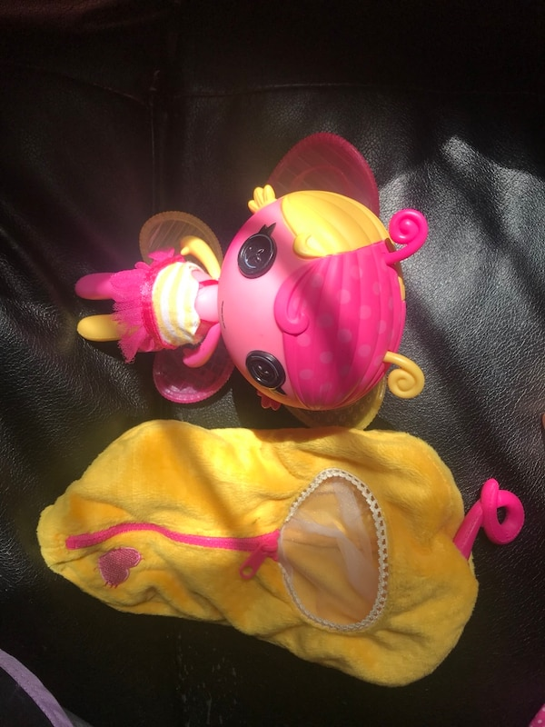 pink and yellow Minnie Mouse plush toy