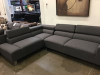 Contemporary sectional with adjustable headrest. Brand new.  Dallas