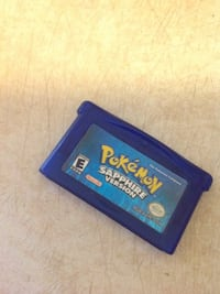 blue and yellow Nintendo DS game cartridge