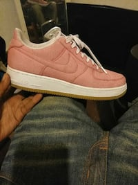 pink, white, and brown Nike Air Force 1 low sneaker