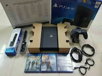 black Sony PS4 console with controller and game cases Pleasant Valley, 12569