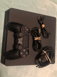 PS4 with 10 games and controller charger